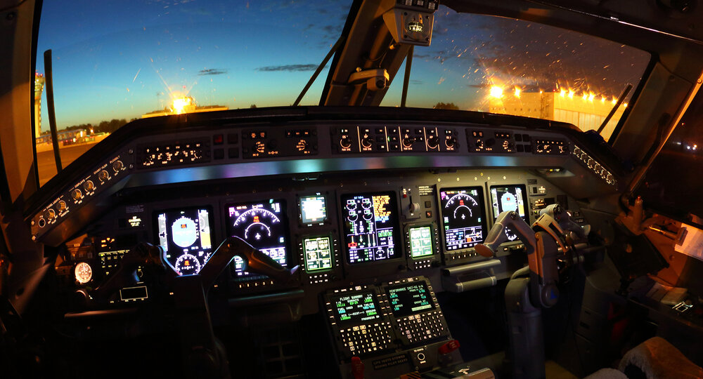 Cockpit,Of,Modern,Civil,Airplane,At,Night.
